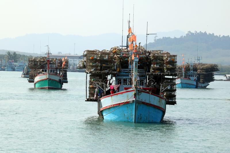 Local fishing boats with fish trap cages on a boat in the river. Along the coast in Thailand royalty free stock image