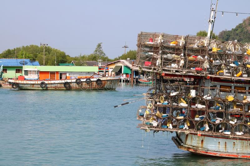 Local fishing boats with fish trap cages on a boat in the river. Along the coast in Thailand stock photography