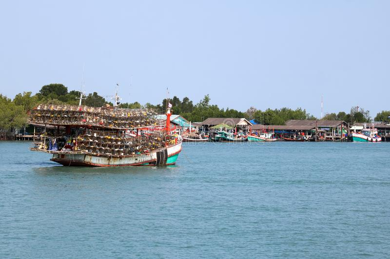 Local fishing boats with fish trap cages on a boat in the river. Along the coast in Thailand royalty free stock photo