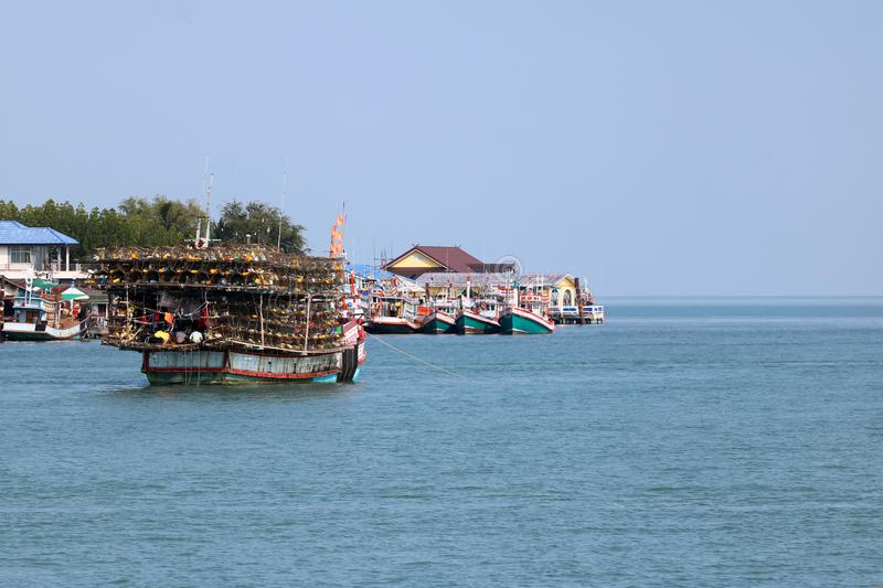 Local fishing boats with fish trap cages on a boat in the river. Along the coast in Thailand stock photo