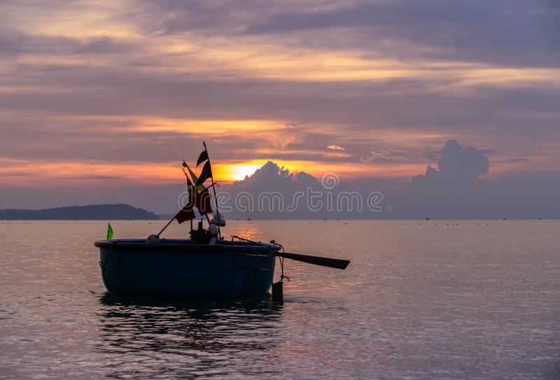 Local fishing boats in the sea with beautiful sky royalty free stock photo