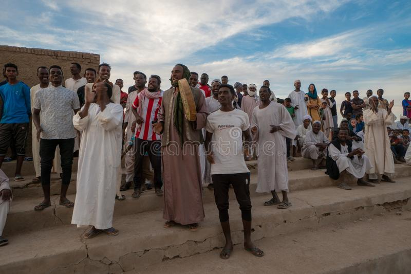 Cheering crowd at a football match in Abri, Sudan - Nov 2018. At a local football match fans from both sides were cheering for their Team royalty free stock image