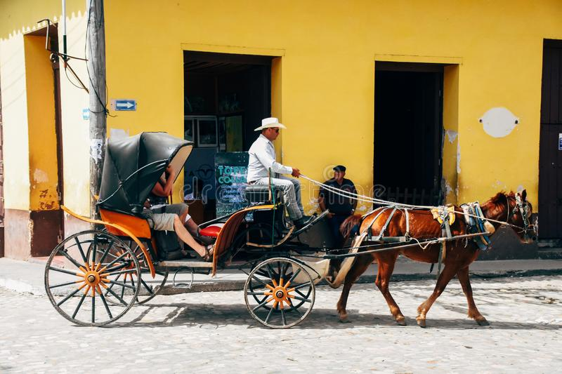 A local horse and carriage ride in Trinidad, Cuba. A amazing local horse and carriage ride in Trinidad, Cuba stock photo