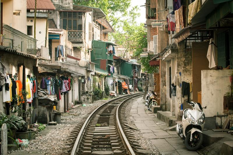 Local houses in Old Quarter. Local houses located close to active railway in Hanoi Old Quarter, Vietnam stock images