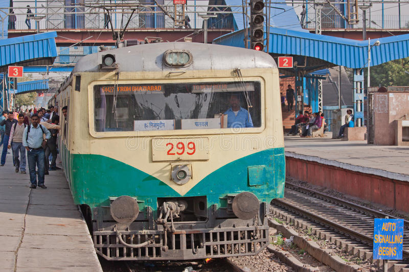 Local Indian Commuter Transport. DELHI, INDIA – FEBRUARY 26, 2015: A commuter train about to leave Shivaji Bridge station for New Delhi. Many of the 25 royalty free stock image