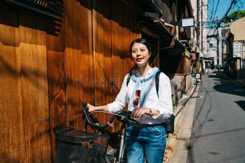 Local Japanese woman is going to work stock photos