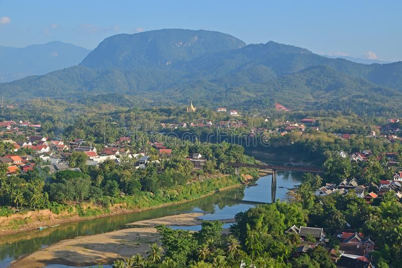 Local landmark of Luang Prabang overlooking the Nam Khan River and local neighborhood with mountains in the background. This image is taken from Mount Phousi