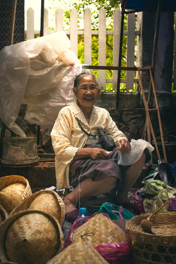 Local Laos woman selling handmade crafts at the market stock photo