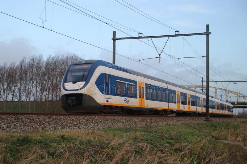 Local light rail communter train type SLT at railroad track between Gouda and The Hague royalty free stock photography