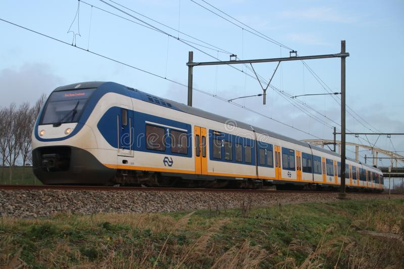 Local light rail communter train type SLT at railroad track between Gouda and The Hagu stock images