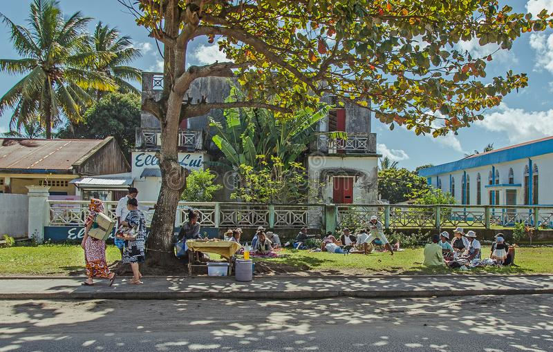 Local malagasy people on the street under the tree stock images