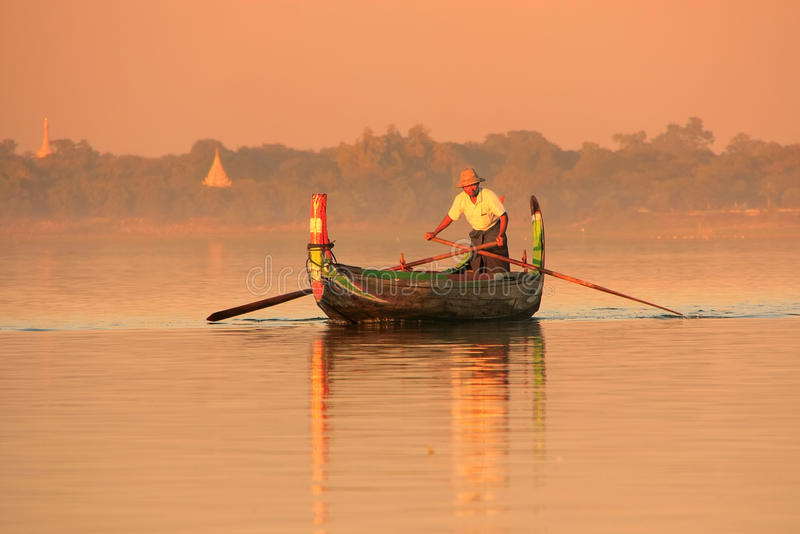 Local man in a boat at sunset, Amarapura, Myanmar. Local man in a boat at sunset, Amarapura, Mandalay region, Myanmar royalty free stock image