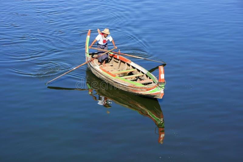 Local man in a boat at sunset, Amarapura, Myanmar. Local man in a boat near U Bein Bridge, Amarapura, Mandalay region, Myanmar stock images