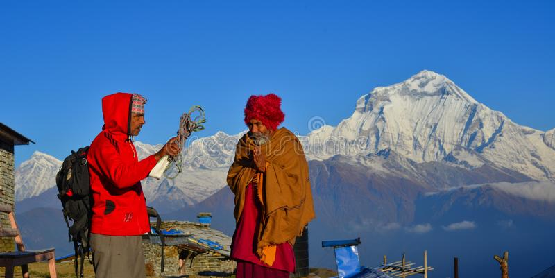 Local man on mountain in Khopra Village, Nepal royalty free stock images
