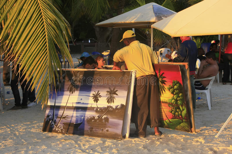 Local man selling paintings at Boca Chica beach stock photo