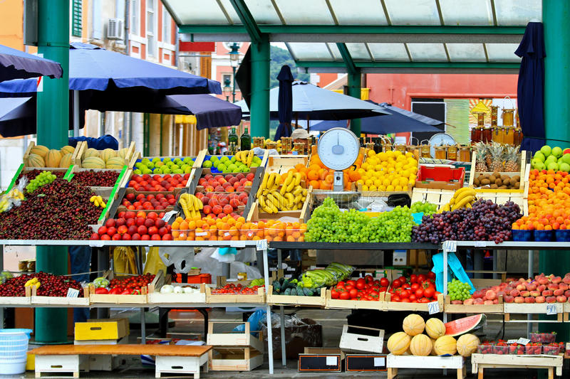 Local market. Fresh fruits and vegetables at farmers market royalty free stock photos