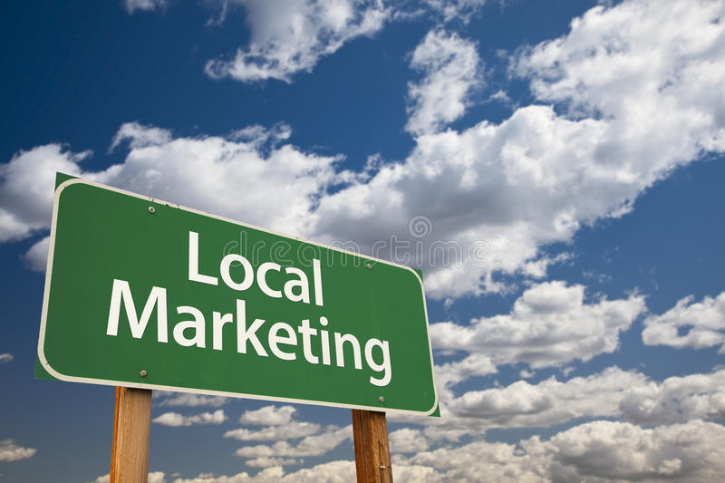 Local Marketing Green Road Sign Over Sky royalty free stock photo