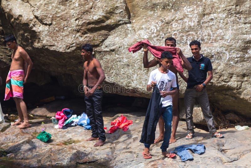 Local men having fun at Ravana falls royalty free stock image