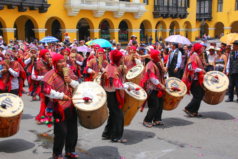 Local men playing drums during Festival of the Virgin de la Candelaria in Lima, Peru royalty free stock photography