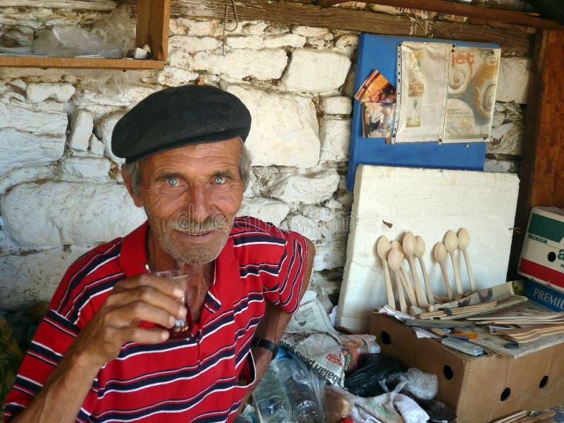 Local old craftsman drinking tea stock photos