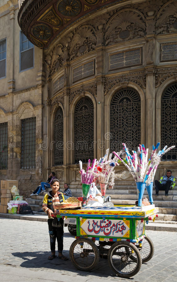 Local peddler selling lupins on a handcart, Moez Street, Cairo. Local peddler selling lupines on a handcart, Moez Street, Cairo, Egypt. One of the traditions of stock photography