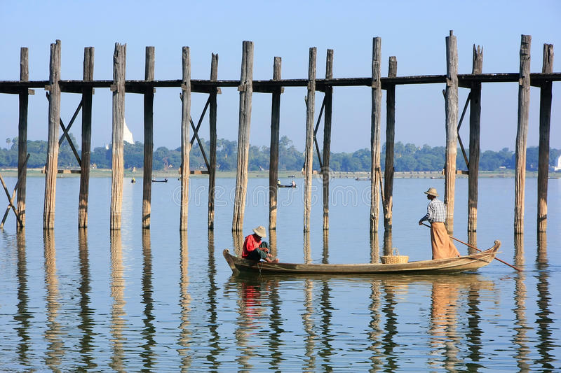 Local people fishing from a boat near U Bein Bridge, Amarapura, stock photography