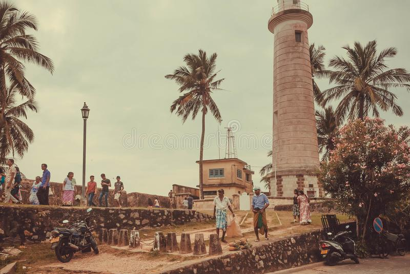 Local people have different business near historical lighthouse stock photo