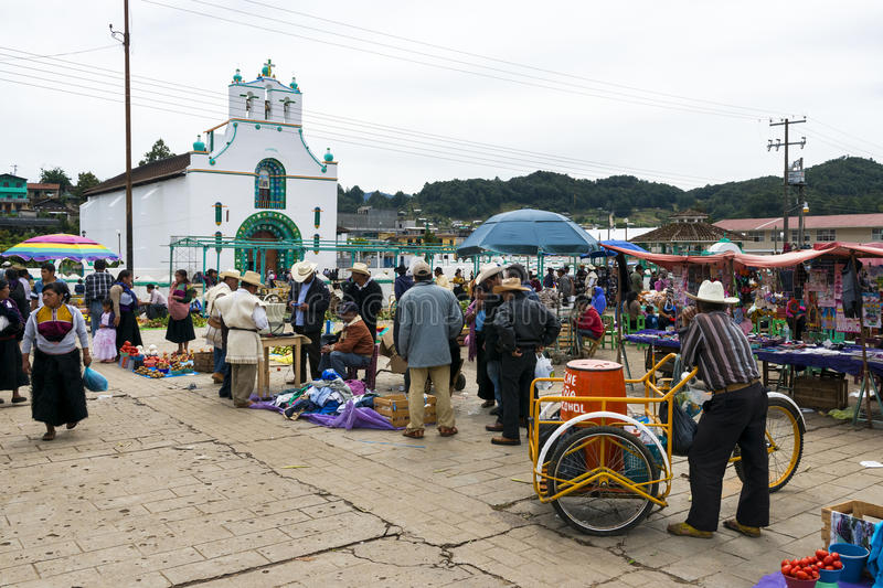 Local people in a market in front of the Church of San Juan in the town of San Juan Chamula, Chiapas, Mexico. San Juan Chamula, Mexico - May 11, 2014: Local stock photos