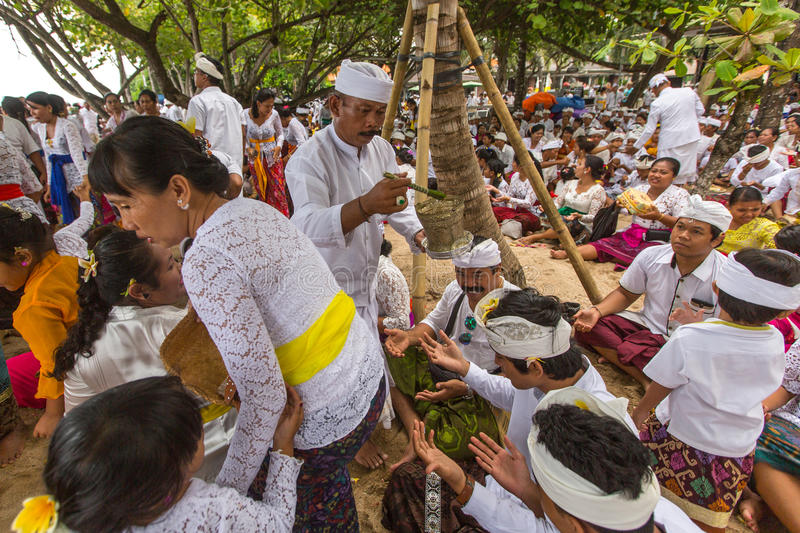 Local people during performed Melasti Ritual. SANUR, BALI - MAR 18, 2016: Unidentified local people during performed Melasti Ritual. Melasti is a Hindu Balinese stock photos