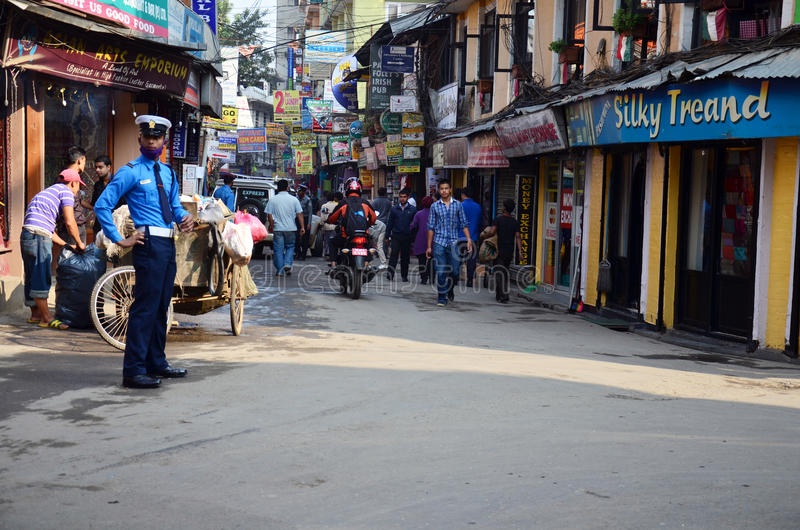 Local people on the street at Thamel market. Thamel is the tourist district of Kathmandu, the capital of Nepal. It is a full Wi-fi zone in Nepal. Thamel has been royalty free stock image