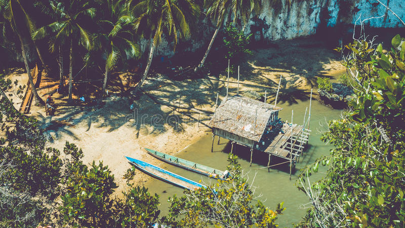 Local people tap new location, Bamboo Hut and Boats on Beach in low Tide, Kabui Bay near Waigeo. West Papuan, Raja Ampat. Indonesia royalty free stock photos