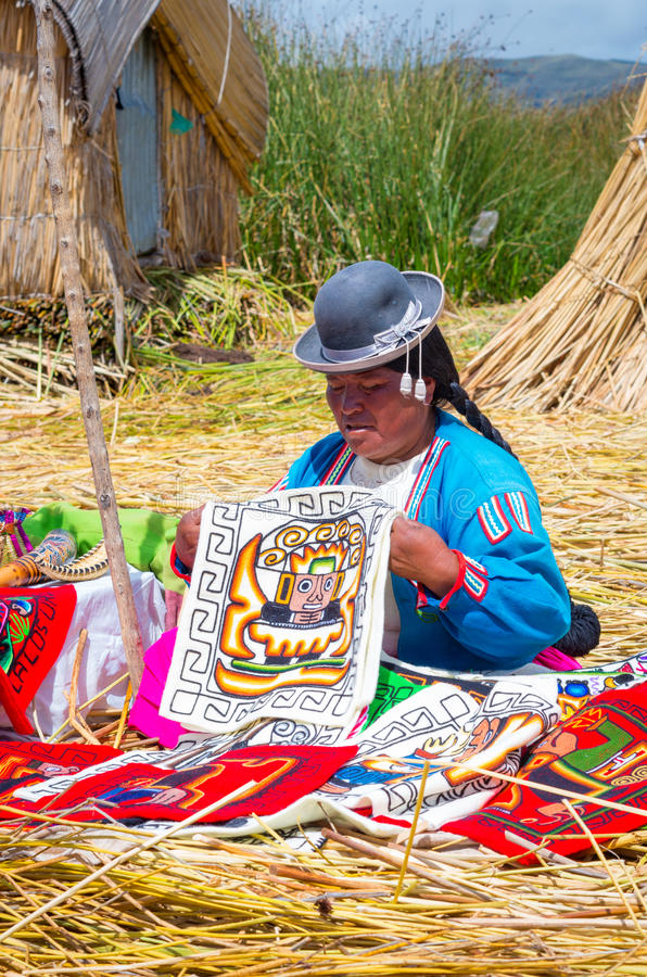 Local people at Uros islands on Lake Titicaca. Peru royalty free stock images