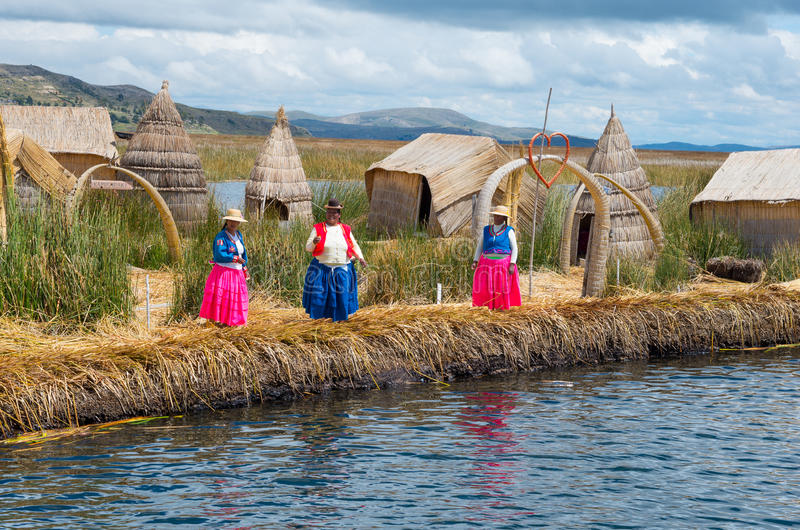 Local people at Uros islands on Lake Titicaca. Peru stock photography