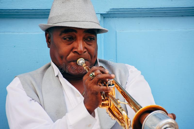 A local playing the trumpet in Havana, Cuba. A well dressed local playing the trumpet in Havana, Cuba stock photography