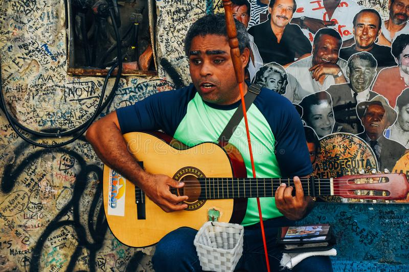 A local plays music for tourists in Havana, Cuba. A blind local plays music for tourists in Havana, Cuba royalty free stock photography