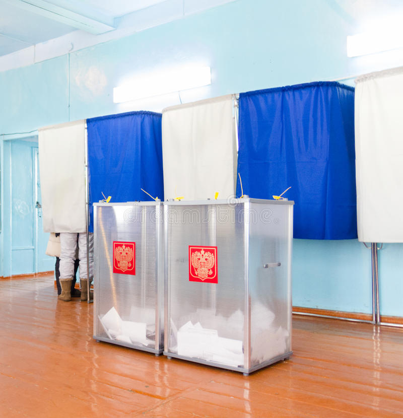 Local polling station, presidential elections in Russia. People behind the curtain vot at the presidential election of Russian Federation royalty free stock photo