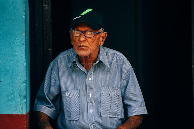 A local posses for the camera in Trinidad, Cuba. A elderly local posses for the camera in Trinidad, Cuba stock image