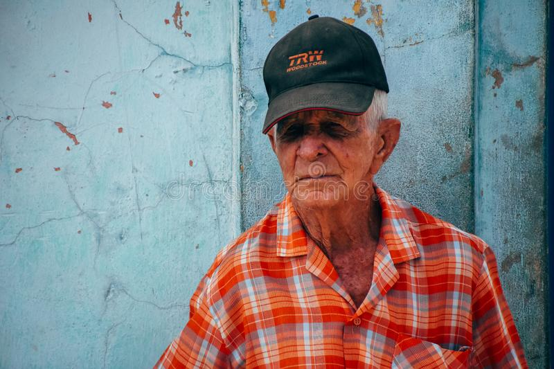 A local posses for the camera in Trinidad, Cuba. A elderly local posses for the camera in Trinidad, Cuba stock photography