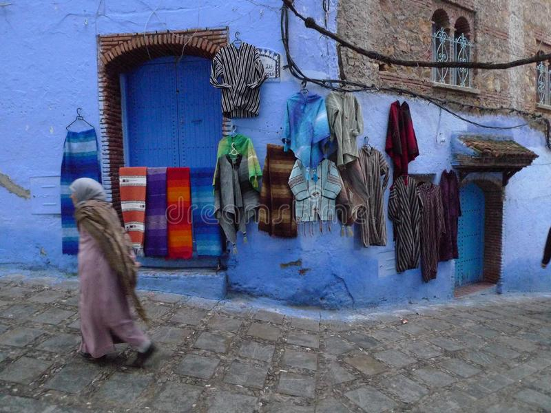 Local products hanging on blue wall in Morocco.  for sale. royalty free stock photography