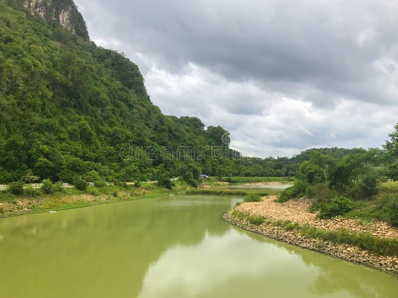 Reservoir and mountain at Phatthalung, Thailand. Local reservoir and mountain at Phatthalung, Thailand royalty free stock photos