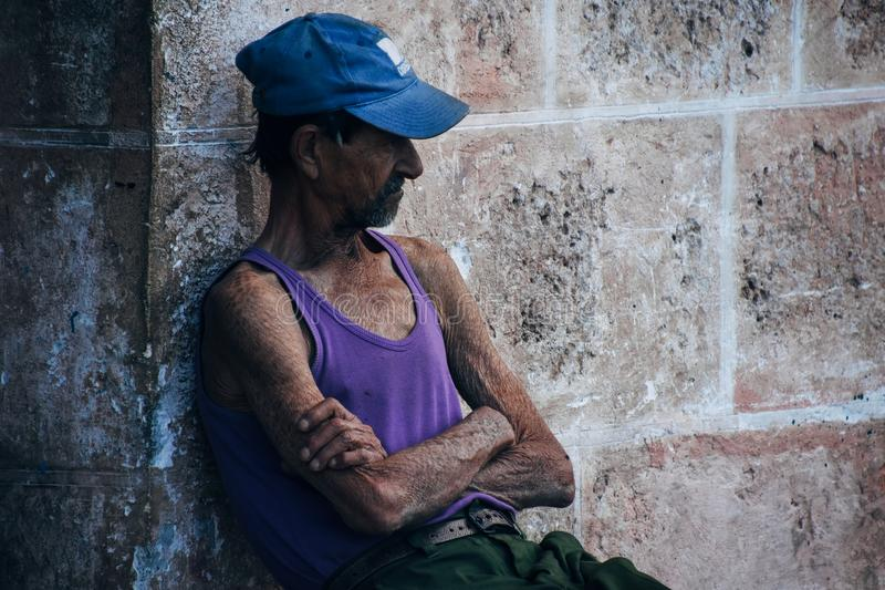 A local rests in the cool shade in Havana, Cuba. A local rests and relaxes in the cool shade in Havana, Cuba stock photo