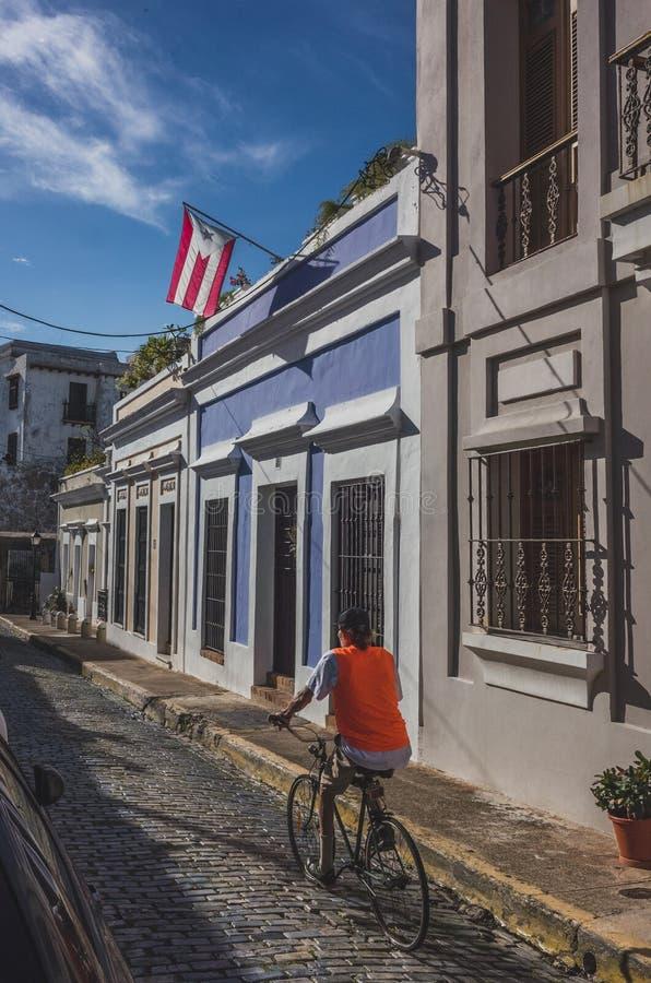 Local riding a bike in old San Juan stock image
