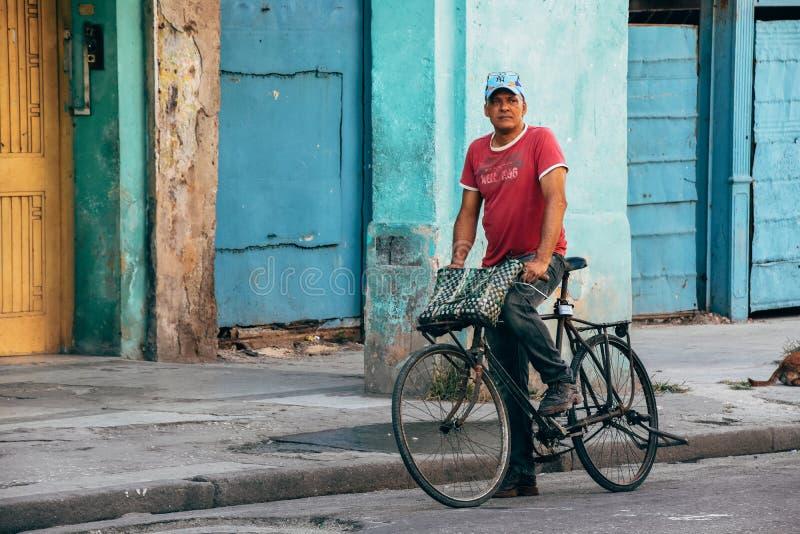 A local riding his bike in Havana city, Cuba. A local riding his classic bike in Havana city, Cuba royalty free stock photos
