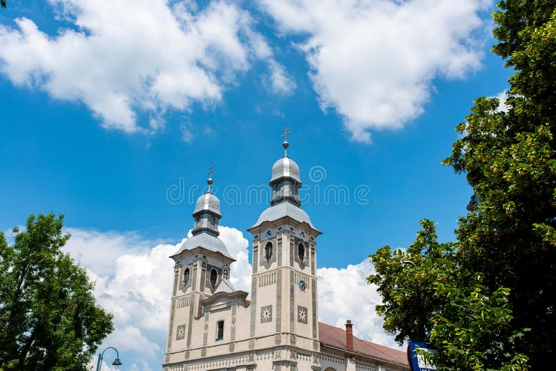 Local Roman Catholic church , blue sky with white clouds. Odorheiu Secuiesc, Romania- 16 June 2019: Local Roman Catholic church , blue sky with white clouds royalty free stock photo