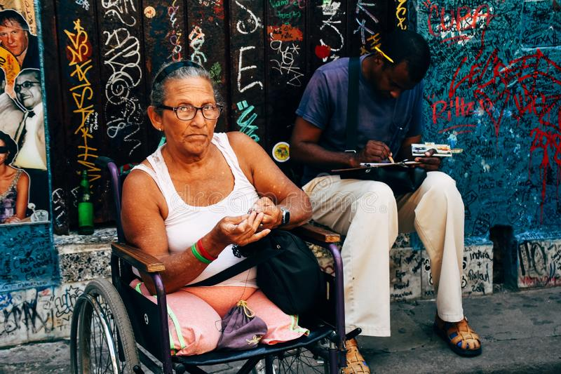 A local sits in the shade in Havana, Cuba. A local sits in the shade to rest in Havana, Cuba stock photo