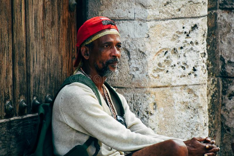 A local sits in the cool shade in Havana, Cuba. A local sits and waits in the cool shade in Havana, Cuba royalty free stock photos