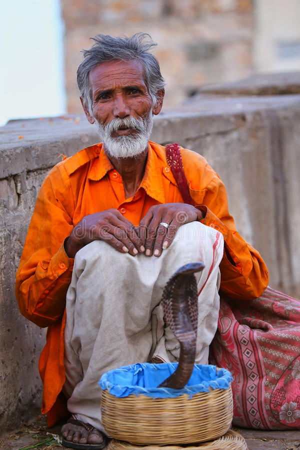 Local snake charmer sitting in the street of Jaipur, Rajasthan,. Local snake charmer sitting in the street of Jaipur, India. Jaipur is the capital and largest stock photos