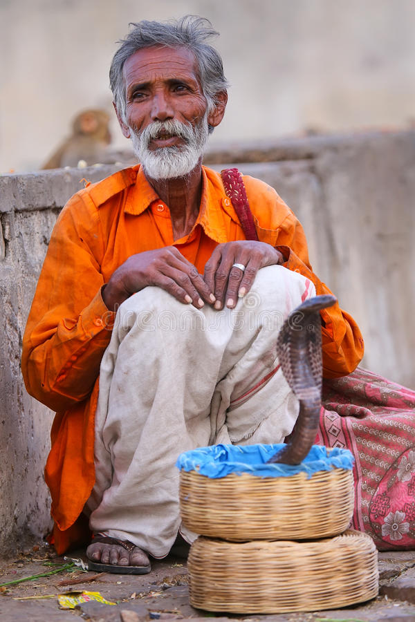 Local snake charmer sitting in the street of Jaipur, Rajasthan,. Local snake charmer sitting in the street of Jaipur, India. Jaipur is the capital and largest royalty free stock image