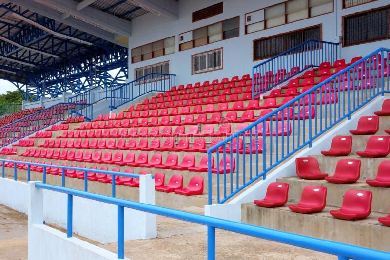 Local stadium seats. In city stock photos