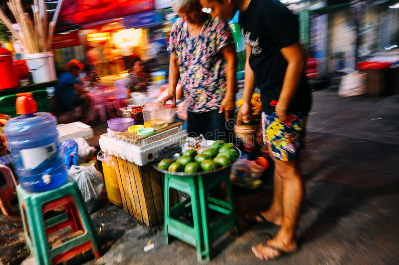 Local street market at night in Yangon. royalty free stock image